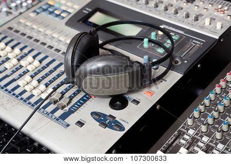 Closeup of headphones on music mixer in recording studio
