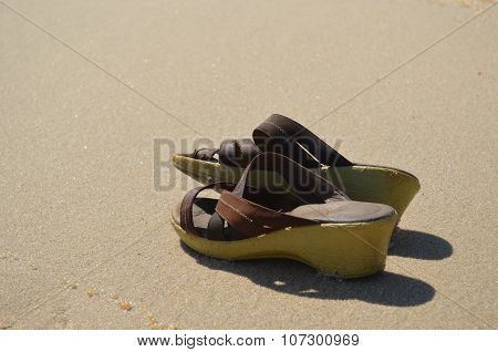 Summer shoes on the sand