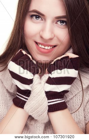 Pretty Girl Smiling With Fingereless Gloves On Hand