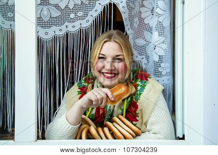 Young Beautiful Woman With Bagels.