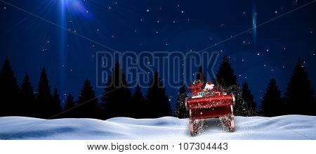 Santa flying his sleigh against bright star in night sky