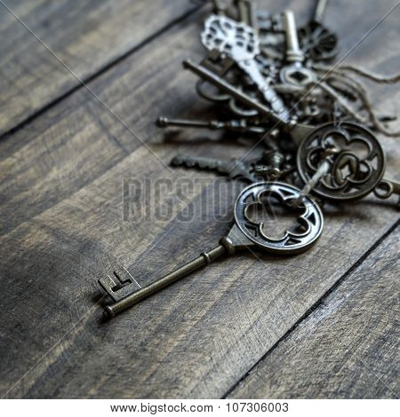 Bunch Of Vintage Keys On Old Wooden Plank