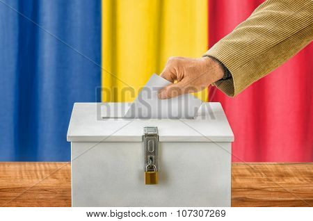 Man Putting A Ballot Into A Voting Box - Romania