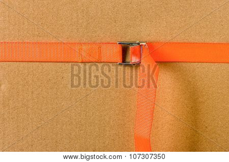 Orange Cam Buckle Strap secureing a box