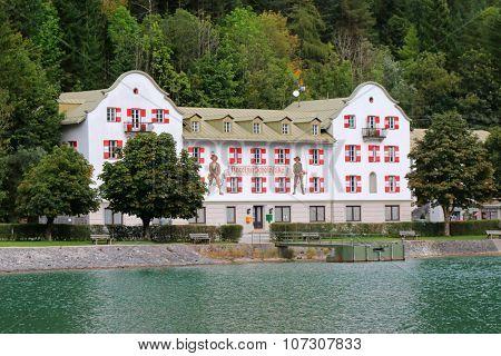 ACHENKIRCH, AUSTRIA - SEPTEMBER 2014 : The Scholastika hotel on Achensee (Lake Achen) in Achenkirch, Austria on September 24, 2015. The facade has frescoes of hunters.