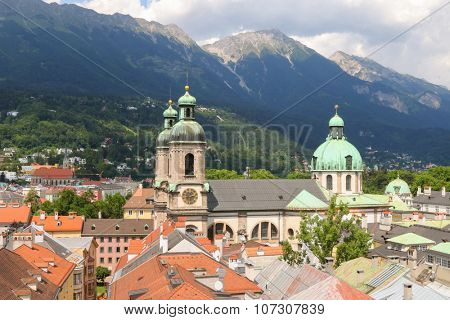 INNSBRUCH, AUSTRIA - JULY 2015 : Bird view of roofs and buildings in Innsbruck city, Austria on July 11, 2015. Photo taken from City Tower (Stadtturn).