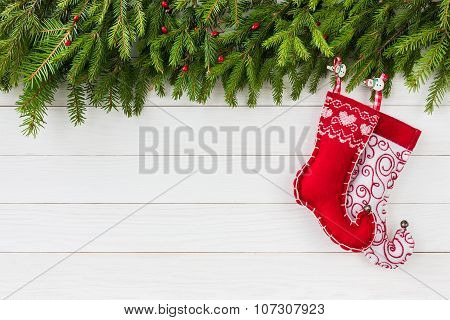 Christmas background. Christmas fir tree, red Christmas socks on white wooden board background with