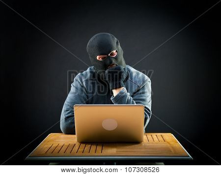 Hackers do not get to crack the laptop. He chews his fist in frustration