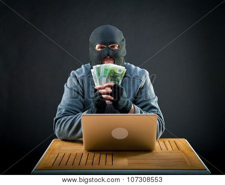 Happy cybercriminal man holding euro cash