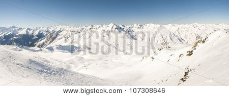 View Of A Snowy Mountain Valley