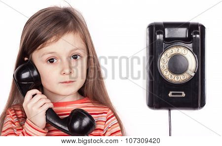 Serious child talking on phone isolated, white background
