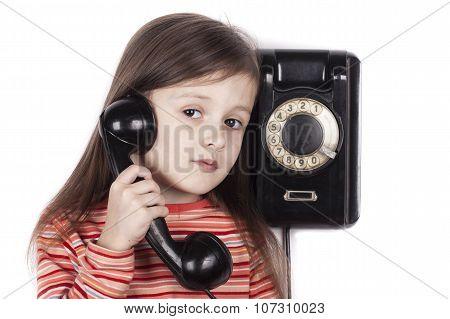 Serious sad child talking on phone isolated, white background