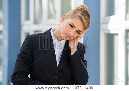 Sad Businesswoman Touching Her Head