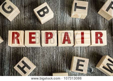 Wooden Blocks with the text: Repair