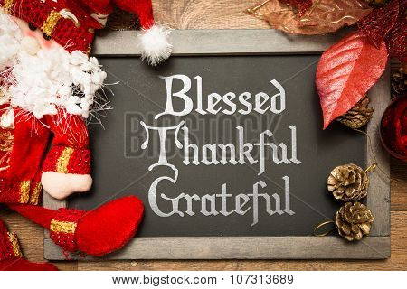 Blackboard with the text: Blessed Thankful Grateful in a conceptual image