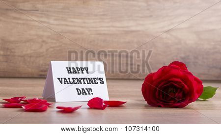 White Greeting Card With A Happy Valentines Day Sign Next To A Beautiful Red Blooming Rose