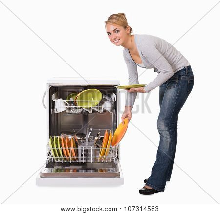 Woman Arranging Plates In Dishwasher Over White Background