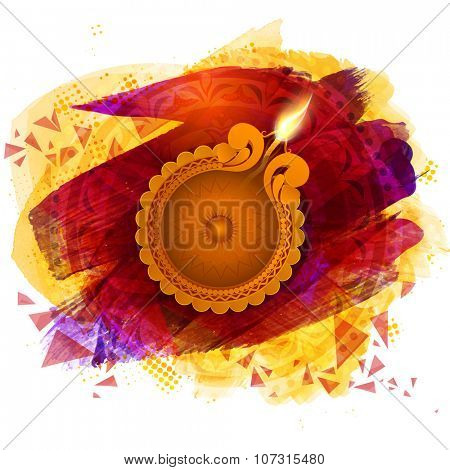 Glossy illuminated oil lit lamp on colourful creative background for Indian Festival of Lights, Happy Diwali celebration.
