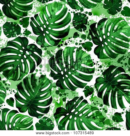 Seamless pattern of leaves monstera with blots