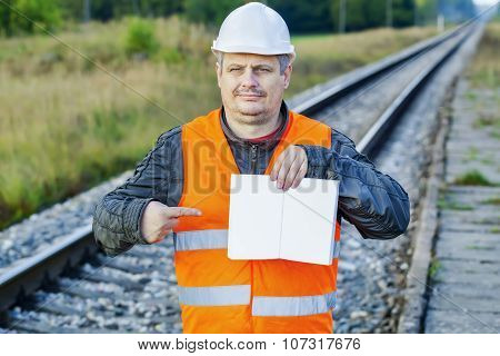 Railway Engineer with open empty book at outdoor on railway
