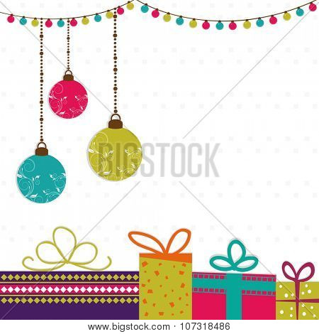 Elegant greeting card design decorated with colorful hanging Xmas Balls, wrapped gifts and lights for Merry Christmas celebration.