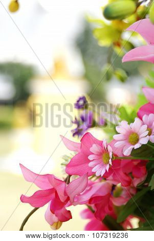 Pink Artificial Flower On Blurred Background