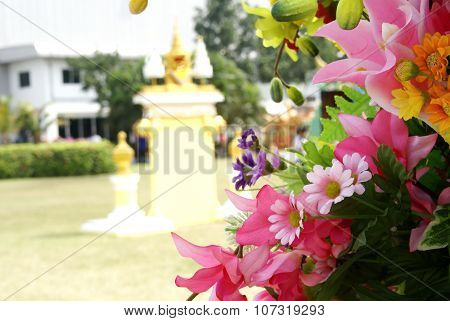 Pink artificial flowers on blurred background
