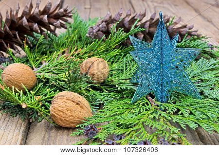 Blue Christmas Star On Green Pine Needles
