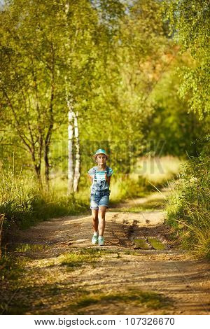 Girl Walks Through The Birch Forest