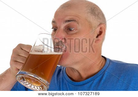 attractive man drinking beer from a mug