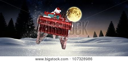 Santa flying his sleigh against full moon over snowy landscape