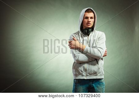 Hooded Man With Big Headphones On Neck