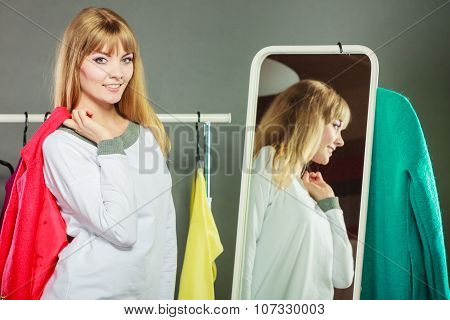 Pretty Girl Looking Into Mirror.