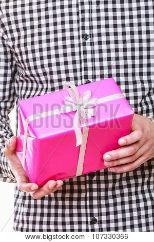 Man Hands Holding Gift Box. Holiday Surprise.