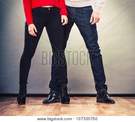 Legs Of Woman And Man. Feet In Footwear Shoes