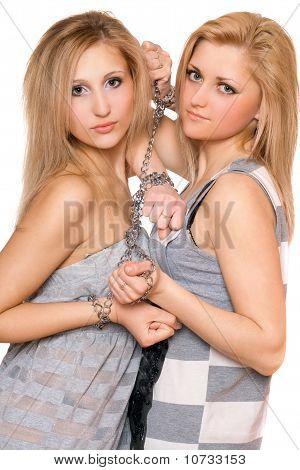 Two Beautiful Young Women Bound A Chain