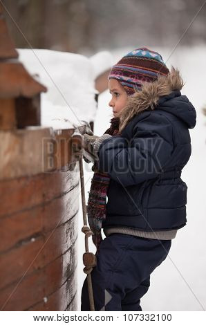 Little Girl Climbing A Rope Ladder