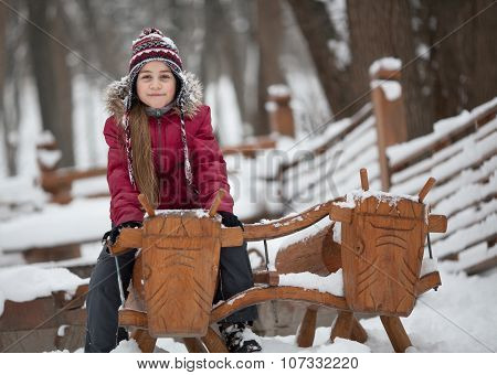 Smiling Girl On Woody Cow
