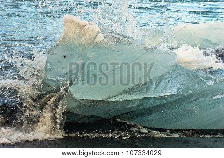 Detail of ice melting in ocean waves,Jokulsarlon glacier lagoon