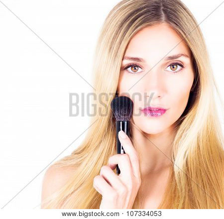 Woman with make-up and brush for rouge. Make-up close up.