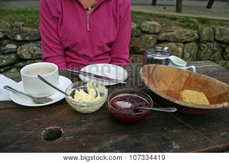 Cream tea on a picnic bench