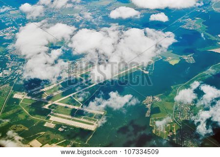 Aerial view on international airport under clouds
