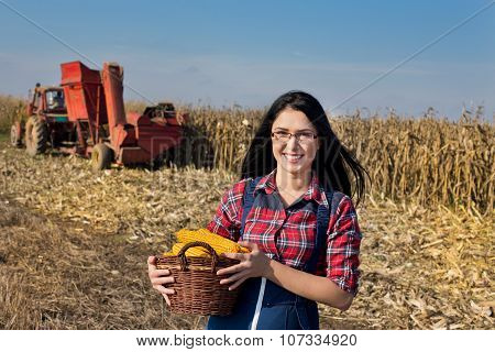 Farmer Girl With Corn In Basket