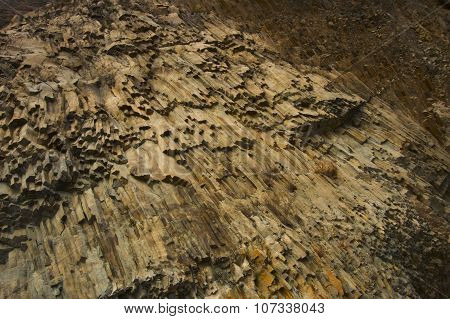A stunning pattern of stones on the rock, similar to the hair