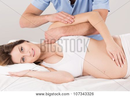 Pregnant Woman At The Physiotherapist