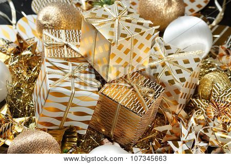 Stacks of golden Christmas presents