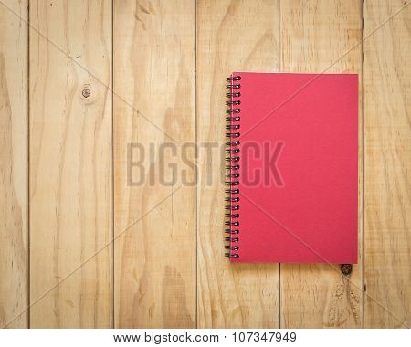 Top View Of Book On Wooden Table Background