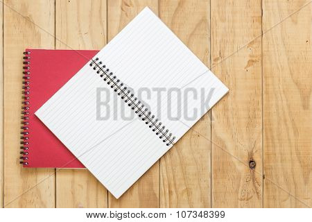 Top View Of Red Open Book On Wooden Table