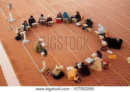 Group of people studying religion inside National Mosque of Malaysia