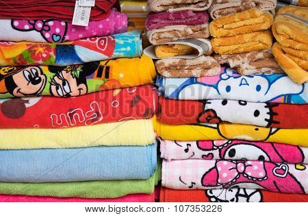 Textile and garment products being displayed for sale at a shop